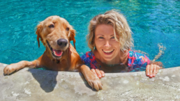 Dog and woman in pool